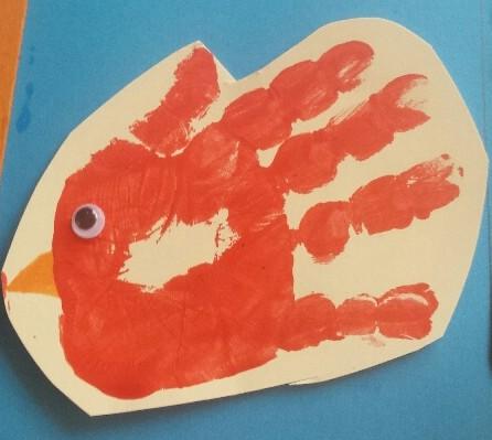 roodborstje van handafdruk